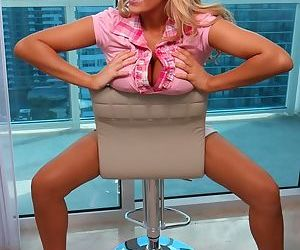 Unbelievable blonde Ember Reigns bends over to show you her tasty pink pussy