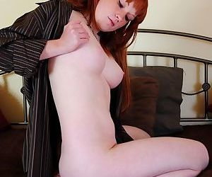 Busty ginger-haired girl gives her pink pussy a good tender massage