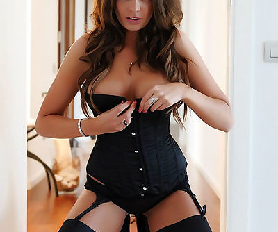 Spicy busty redhead model Liberty Parisse flaunts in perfect black lingerie and stockings