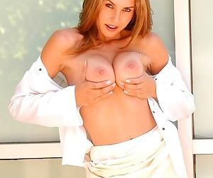 A beautiful girl with a bald pussy gropes her sexy natural titties