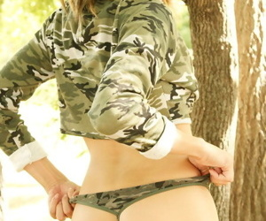 Very sexy teen sweeping dressed in army lingerie