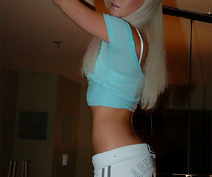 Teen in sheer tee is stripping and lets you see her amazing little pussy