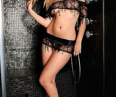 Sweet smiling Sophia Knight tempts in black lingerie and sheer panties