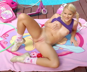Charming teen pretty good switches from her cute toys nigh a big metal cock