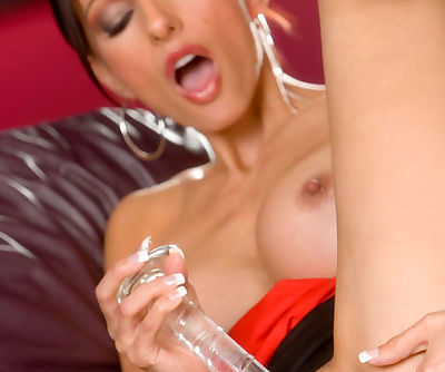 Amazing beauty enjoys warm solo while gently shaking her big tits
