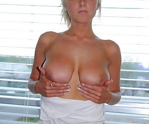 She models her tits and her slick young pussy