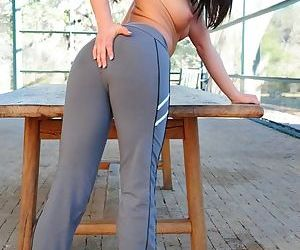 She rubs a finger all over her pussy and she looks hot in those workout pants