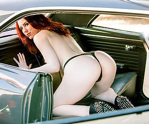 Topnotch redhead strips in the car and reveals her nice body with milky skin and natural titties