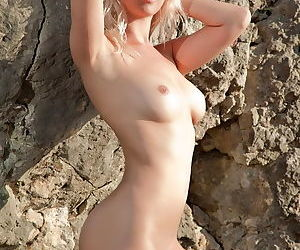 Perky breasts beauty with a soft ass and a shaved pussy naked outdoors