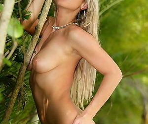 Hot blonde shows off her sexy titties and her beautiful pussy outdoors
