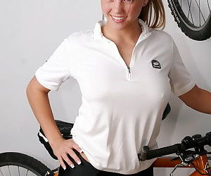 Smiling blond adolescent erotic dancing bike outfit