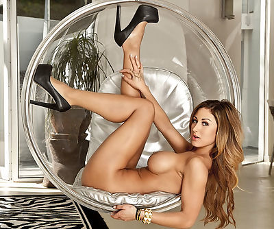 Bubble butt cutie makes fancy posing in chic stockings and we can check out sweet clit