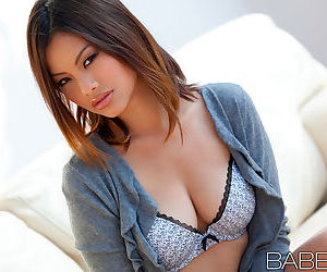 Asian Kyanna Song with luscious lips and hot tits in outdoor pic set