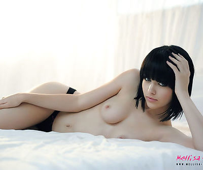 Teen Mellisa Clarke in a loose sweater and stripping to her naked tits