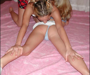 Incredible young strumpets undressing gathered on the sofa