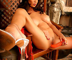 Big orange dildo about to fuck the fresh pussy of model Tera Patrick