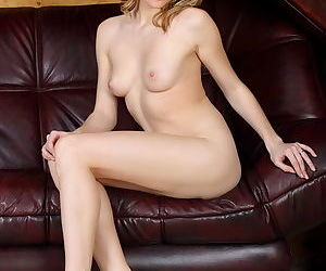 Babe with blonde hair and a super hot and tight body shows her shaved pussy