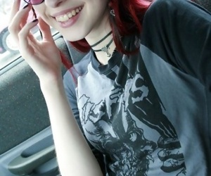 Teen goth flashing in the car increased by flashily smiling