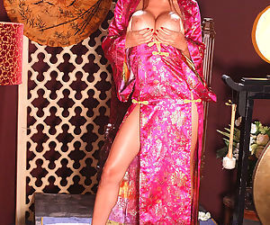 Asian silk dress is gorgeous on big tits brunette model Tera Patrick solo