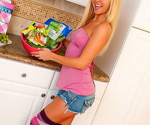 Girl fucks her pussy with vegetables instead of making a tasty snack