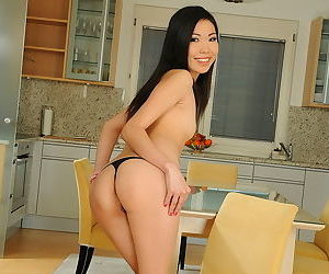 Tiny skirt and slutty top grace the Asian body of the ass play girl