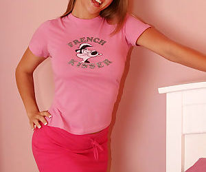 Cute teen chick posing in her pink sleepwear