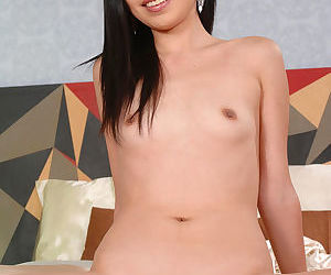 Awesome Asian cutie Nicoline Yiki has nice dark pussy lips and she exposes her pink innier slit