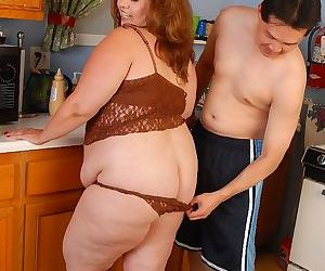 Overweight housewife Cyn eating cumshot out of hand in kitchen