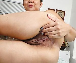 Middle-aged Asian punker Lulu Sparkle spreads her natural pussy wide open
