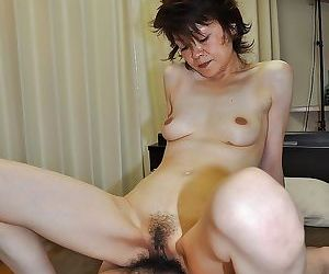 Asian lady gives a blowjob with ball licking and gets her hairy cunt nailed