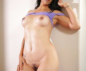 Mature Asian-American woman Dana Vespoli slips off see thru lingerie set