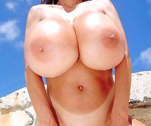 South Korean solo model Minka unveils her monster tits at the beach