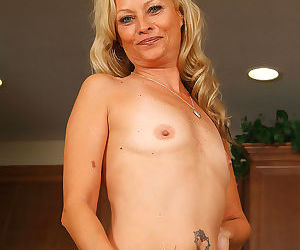 Cute blonde 47 year old strips off her red latex - part 2044