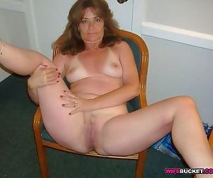 Amateur matures spread tits and pussies - part 1969