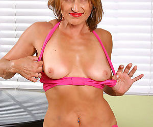 Jillian strips out of her clothes and shows her milf pussy - part 600