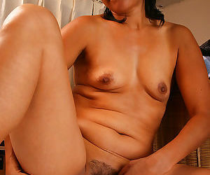 42 year old dez strips and spreads her furry pussy - part 878