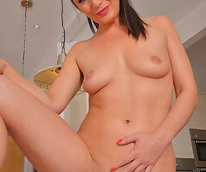 Brunette housewife roxanne cox undressing to spread long legs in the kitchen - part 1101
