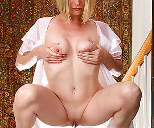 Blonde milf in see through lingerie spreads her shaven pussy - part 960