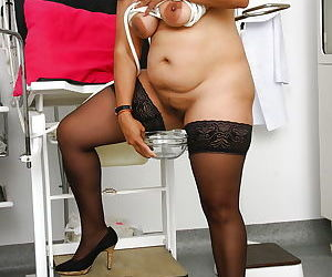 Overweight Indian woman Alice stripping down to stockings in gyno office - part 2
