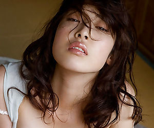 Bosomy asian cutie Saki Koto uncovering her seductive body