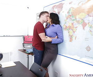 Older brunette teacher Reagan Foxx banging a male student in classroom
