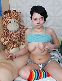 Innocent teen girl Lilly Marie exposes her tits while giving her first handjob
