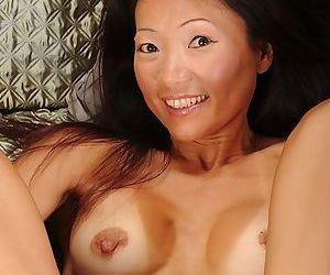 Asian mature Natsuko Kurosawa posing and fingering her asshole - part 2
