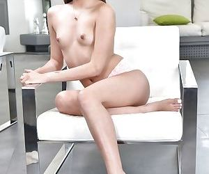 Clothed Asian babe Zaya Cassidy spreading sexy legs after undressing - part 2