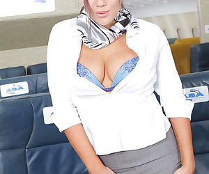 Gorgeous asian air hostess stripping down and teasing her gash