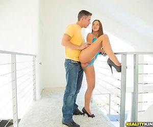 Teen hottie Amirah Adara posing in high heels and revealing clothing