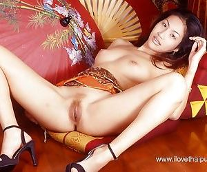 Asian babe teases her hairy pussy and big tits while playing with toys - part 2