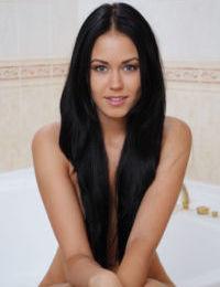 Slender raven-haired bombshell Macy strips down in the bathroom - part 2