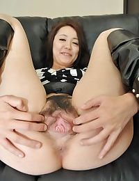 Japanese MILF Aya Nakano takes off her shorts and has some fur pie toying getting pleasure