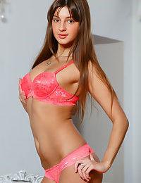 Cute teenage lass in pink lingerie Melena unveils her orgasmic beaver